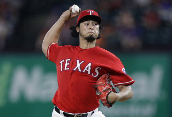 ARLINGTON, TX - AUGUST 12:  Yu Darvish #11 of the Texas Rangers throws against the Detroit Tigers in the third inning at Globe Life Park in Arlington on August 12, 2016 in Arlington, Texas.  (Photo by Ronald Martinez/Getty Images)