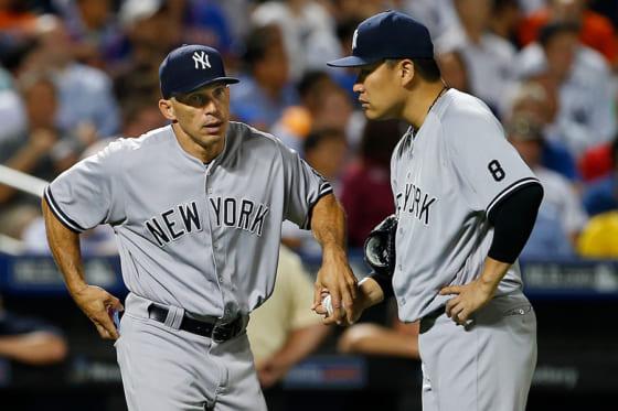 2017年までヤンキースの監督を務めたジョー・ジラルディ(左)と田中将大【写真:Getty Images】